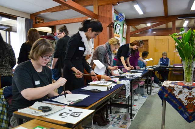 ZaCSA members learn how to make Japanese kanji characters of their own during a Calligraphy Workshop, the last cultural event of the 2015-16 ZaCSA membership year. (U.S. Army photo by Nano Betts)