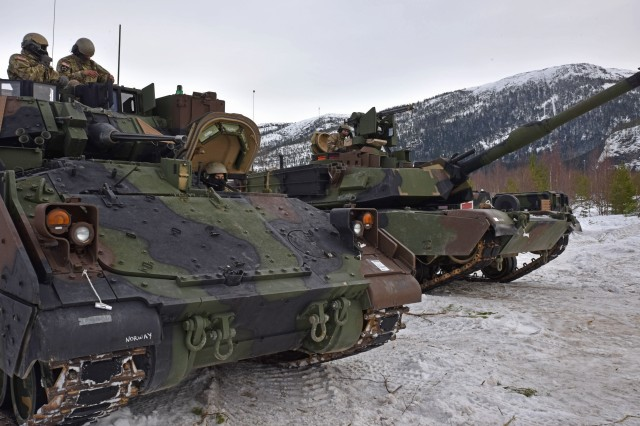 Armored vehicles from 2nd Battalion, 7th Infantry Regiment, 1st Armored Brigade Combat Team, 3rd Infantry Division, prepare to move during Exercise Cold Response 16, a Norwegian-led cold weather training exercise. U.S. Army units bundled up and headed to Norway to join 13 countries for intense cold weather training at Exercise Cold Response 16. Cold Response is a regularly scheduled Norwegian-led joint multinational exercise with a focus on high-intensity operations in winter conditions. This year is the first time the 13 participating nations are joined by the U.S. Army.