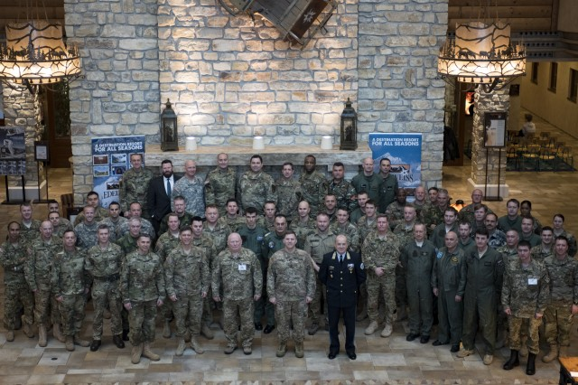 Attendees of the first annual Strong Europe Aviation Rotary Wing Summit pose for a group photo at the Edelweiss Lodge and Resort conference center, Garmisch-Partenkirchen, Germany Mar. 1-2, 2016. The conference, hosted by the 12th Combat Aviation Brigade, was aimed at gathering Aviators from all over Europe in order to build common understanding, establish future joint training, and develop habitual relationships and partnerships between the Allied nations.
