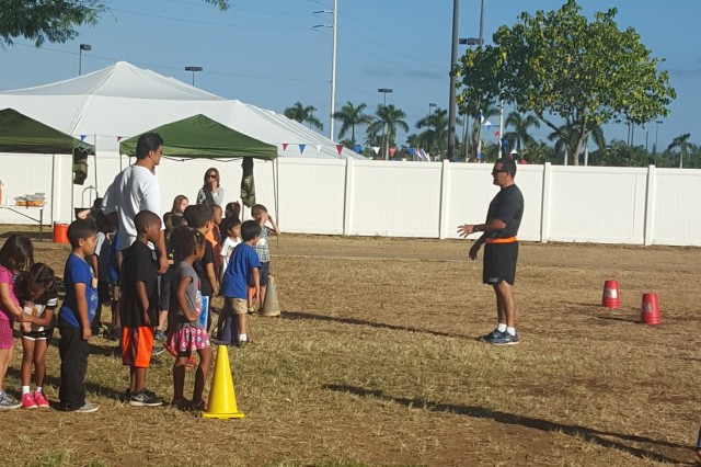 U.S. Army Sgt. Pete Garcia, who serves as a motor sergeant with 94th Army Air and Missile Defense Command, U.S. Army Pacific, gives instructions for the cup stack relay to elementary school children, Feb. 26, 2016, during a Jump Rope for Heart event at the Pearl Harbor Elementary School. The event is a national education and fundraising event sponsored by the American Heart Association and the Society of Health and Physical Educators (SHAPE) where students learn how to develop heart-healthy habits while being physically active. (U.S. Army photo by Sgt. Geysi Johnson, 94th Army Air and Missile Defense Command)