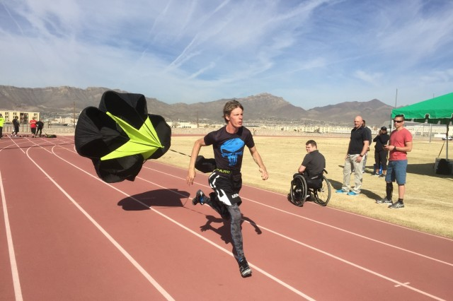 U.S. Army veteran Spc. Terry Cartwright, of Safford, Ariz., sprints with a training parachute at Stout Track, Fort Bliss, Texas, March 3, 2016. More than 100 wounded, ill and injured Soldiers and veterans are at Fort Bliss to train and compete in a series of athletic events including archery, cycling, shooting, sitting volleyball, swimming, track and field, and wheelchair basketball. Army Trials, March 6-10, are conducted by the Department of Defense Warrior Games 2016 Army Team.