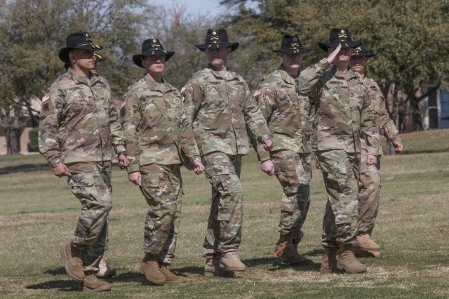 The staff officers of the 3rd Armored Brigade Combat Team, 1st Cavalry Division salute the incoming and outgoing commanders during the pass in review portion of the change of command ceremony March 4 at Fort Hood, Texas. Col. John Woodward, a Killeen, Texas, native, assumed command of the 3rd ABCT from Col. Matthew Van Wagenen, a native of Pittsburgh, in a ceremony on Cooper Field. (U.S. Army photo by Staff Sgt. Leah R. Kilpatrick, 3rd Armored Brigade Combat Team Public Affairs Office/released)