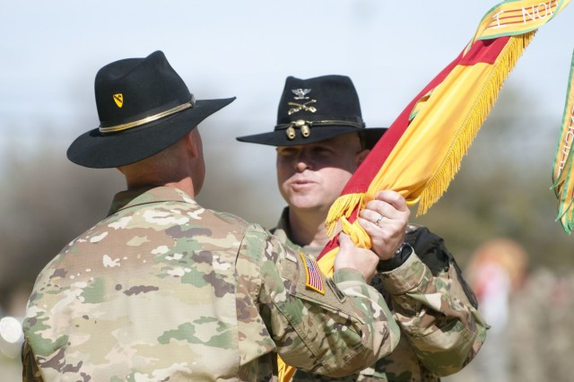 "Col. John Woodward, incoming commander of the 3rd Armored Brigade Combat Team, 1st Cavalry Division, receives the brigade colors from Maj. Gen. John Thomson, 1st Cavalry Division commanding general, in a change of command ceremony March 4  at Fort Hood, Texas. Receiving the colors signifies taking command of the unit. ""I know that you will ride the ride and live the legend in fine cavalry fashion,"" Thomson said to Woodward. ""You have my full trust and confidence."" (U.S. Army photo by Staff Sgt. Leah R. Kilpatrick, 3rd Armored Brigade Combat Team Public Affairs Office/released)"