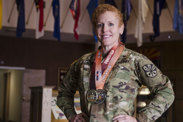 Lt. Col.  Zoe Ollinger, a member of the Arizona Army National Guard, wears her medal from past triathlons she has competed in. She uses her military experience to help plan her race strategy and her race mentality to lead her through life, one buoy at a time.
