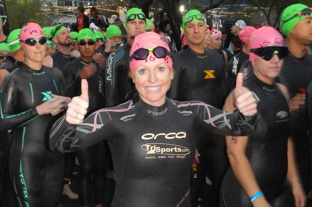 Lt. Col.  Zoe Ollinger, a member of the Arizona Army National Guard, gets ready to enter the waters of Tempe Town Lake for the first event of a triathlon, a 2.5 mile swim.