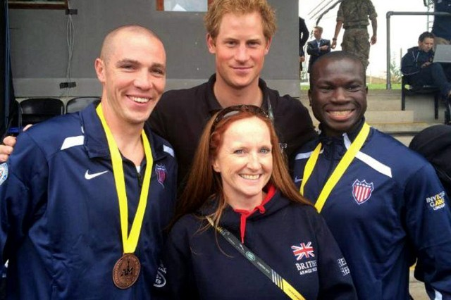 Retired Army Captain Will Reynolds, right, takes a break at 2014 Invictus Games in London with Prince Harry.