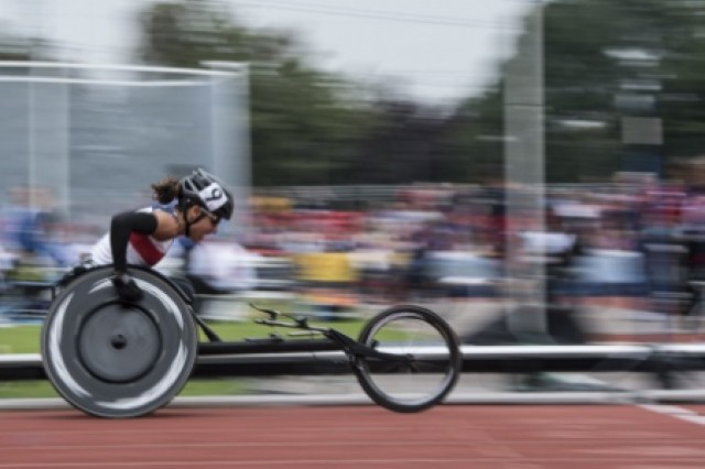U.S. Army 1st Lt. Kelly Elmlinger competes in a wheelchair 100 meter sprint during the Invictus Games at the Lee Valley Athletics Centre, London, Sept. 11, 2014. Athletics is one of several sports over 300 wounded warriors from 13 nations will compete in including archery, wheelchair basketball, road cycling, indoor rowing, wheelchair rugby, swimming and sitting volleyball. The vision for the Invictus Games is to harness the power of sport to inspire recovery, support rehabilitation and generate a wider understanding and respect for those who serve their country.