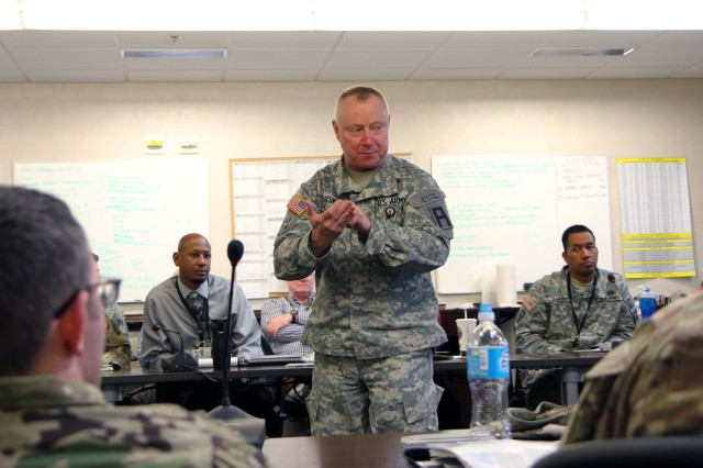 Col. Timothy Bush, First Army Chief of Operations, Plans and Training, speaks to a group of First Army observer coach/trainers during a two-day conference discussing military intelligence and security readiness at First Army headquarters at Rock Island Arsenal, Ill., March 1-2.  Bush told the attendees that this is the time to establish and foster relationships with reserve-component units. (Photo by Staff Sgt. Nazly Confesor, First Army Public Affairs)