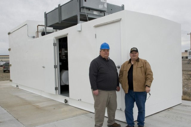Brent Sigvardt (left), an engineering technician for the Smoke & Obscurants Branch; and Jim Barnett, chief of the same branch, outside the new solar radiation facility. They worked together to research the new chamber. It was built for nearly $700,000 by Mallory Engineering of Woods Cross, Utah. (Photo by Al Vogel, Dugway Public Affairs)