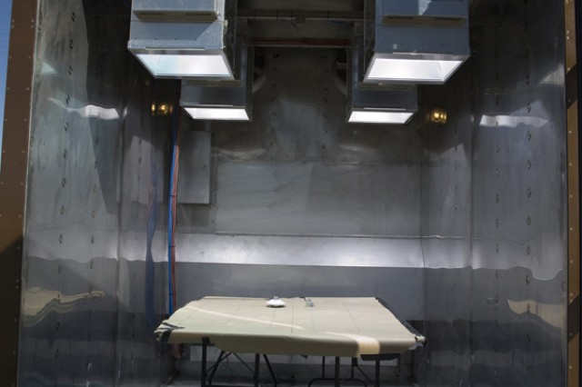 The 8X10-foot solar radiation chamber during verification of its newly installed lamps. Sensors on the table measure the light produced. In use, items undergoing testing will be placed on the floor, to better replicate the sun's passing. (Photo by Al Vogel, Dugway Public Affairs)