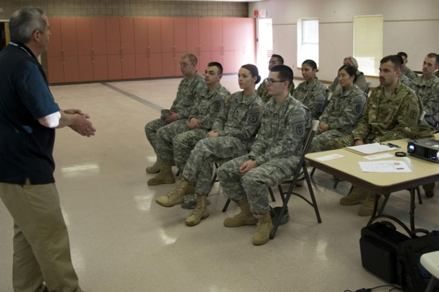 Brent Console, assistant Army Emergency Relief officer for Dugway Proving Ground, briefed Soldiers and civilians about the need to contribute to AER. It provides emergency financial assistance to soldiers and their families. For every dollar contributed, 88 cents funds no-interest loans, grants and scholarships (scholarship deadline May 1, 2016). (Photo by Al Vogel, Dugway Public Affairs)