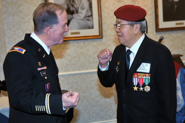 PRESIDIO OF MONTEREY, California -- Silver Star recipient Col. (Ret.) William Reeder Jr. chats with former South Vietnamese Army officer Lt. Col. Li Van Me after Reeder Jr's awards ceremony here March 8.