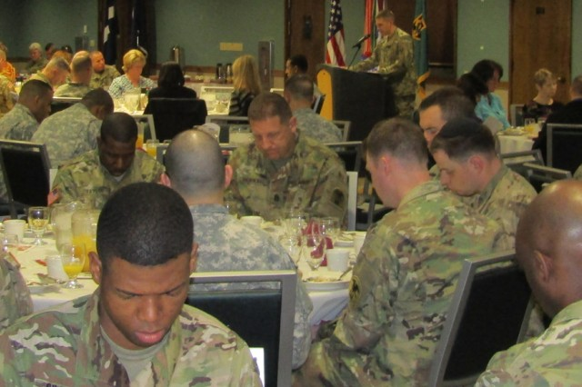 Service members, Family members and Department of the Army civilians take time to pray during the Maneuver Support Center of Excellence and Fort Leonard Wood observance of the 2016 National Prayer Breakfast Tuesday at Pershing Community Center.