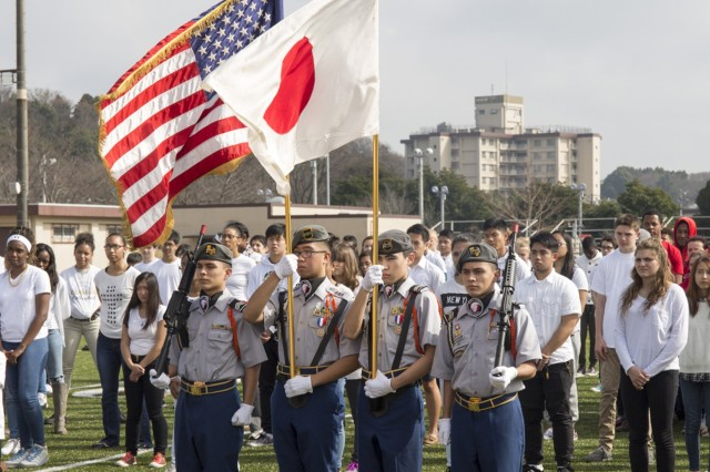 ZAHS JROTC post the colors during a ceremony in tribute to victims of the Tohoku earthquake and tsunami March 8 on the school's football field. (U.S. Army photo by Lance D. Davis)