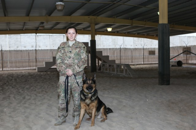 Spc. Suzanne Precour with her military working dog Max.