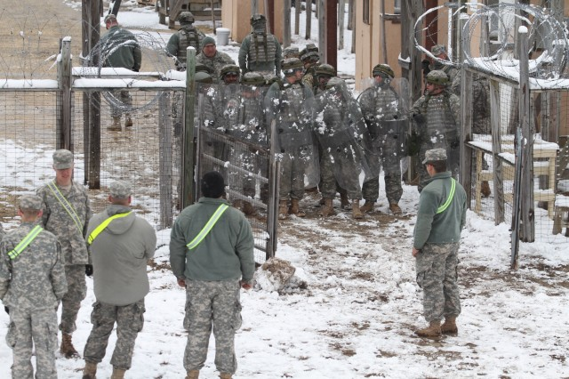 Soldiers equipped with riot shields conduct detainee operations on Joint Base McGuire-Dix-Lakehurst, N.J., March 4, 2016. Soldiers of the 367th MP Company are participating in Combat Support Training Exercise 78-16-01 to improve unit readiness.