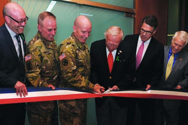 Dr. Scot Engel, Col. Mark Thompson, Brig. Gen. Rodney Fogg, Arthur Fisher, former Texas governor Rick Perry and U.S. Representative John Carter (R-Texas), cut the ribbon to open the newest Intrepid Spirit Center at Fort Hood, Texas, March 9. (U.S. Army photo by Nick Conner, Fort Hood Public Affairs)