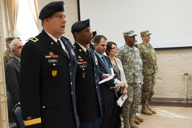 Maj. Gen. Kevin O'Connell, commanding general, U.S. Army Sustainment Command, sings the Army Song with community leaders during Rock Island Arsenal's second quarterly Award, Retreat and Retirement Ceremony, March 9. (Photo by Kevin Fleming, ASC Public Affairs)