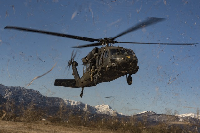 A UH-60L Black Hawk helicopter from 3rd Battalion, 227th Aviation Regiment, 1st Air Cavalry Brigade, Task Force Spearhead, 12th Combat Aviation Brigade, approaches the Frida drop-zone for sling load training with 173rd Airborne Brigade, Pordenone, Italy, Mar. 9, 2016. Sling load training prepares Soldiers to deliver and move equipment in a quick, safe and efficient manner. (U.S. Army photo by Sgt. Thomas Mort, 12th CAB)