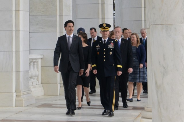 Justin Trudeau, prime minister of Canada, is escorted by Maj. Gen. Bradley A. Becker, U.S. Army Military District of Washington commanding general, during an Armed Forces Full Honors Wreath-Laying Ceremony with to honor America's fallen at the Tomb of the Unknown Soldier at Arlington National Cemetery, Va., March 11, 2016.