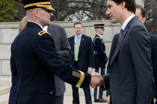 Maj. Gen. Bradley A. Becker, U.S. Army Military District of Washington commanding general, greets Justin Trudeau, Prime Minister of Canada, during an Armed Forces Full Honors Wreath-Laying Ceremony at the Tomb of the Unknown Soldier at Arlington National Cemetery, Va., March 11, 2016.