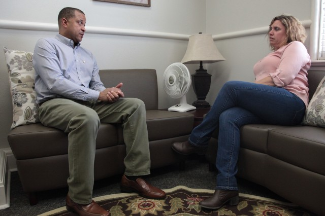 Gold Star husband Kelvin Triggs asks Lori Dean, Survivor Outreach Services support coordinator, about his survivor benefits at the program's office in Fort Sam Houston, Texas, March 11, 2016. SOS offers resources including supportive counseling, financial education, benefits coordination, and support groups to surviving Family members like Triggs for as long they desire.