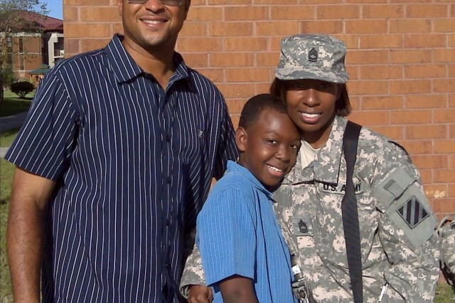 In an undated photo, Master Sgt. Marcia Triggs and her husband Kelvin pose with their son Nick. An Army veteran himself, Kelvin became a Gold Star husband after Marcia's death in 2011.