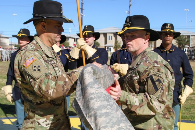 "Col. John DiGiambattista (left), commander, 1st Armored Brigade Combat Team ""Ironhorse,"" 1st Cavalry Division, and Command Sgt. Maj. Michael Coffey, 1st ABCT, case the brigade colors Jan. 28 on Cooper Field at Fort Hood, Texas. (U.S. Army photo by Sgt. Fred Brown, 1st Armored Brigade Combat Team Public Affairs, 1st Cavalry Division)"