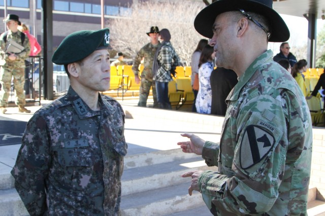 Col. John DiGiambattista (right), commander, 1st Armored Brigade Combat Team, 1st Cavalry Division, discusses the brigade's nine-month rotation to the Republic of Korea with Maj. Gen. Kyoung Soo Shin, ROK defense attache' to the United States, after a colors casing ceremony on Cooper Field at Fort Hood, Texas, Jan 28. Ironhorse Soldiers will participate in several joint and multinational exercises with ROK forces, and work with Korean augmentees to the United States. (U.S. Army photo by Sgt. Fred Brown, 1st Armored Brigade Combat Team Public Affairs, 1st Cavalry Division)