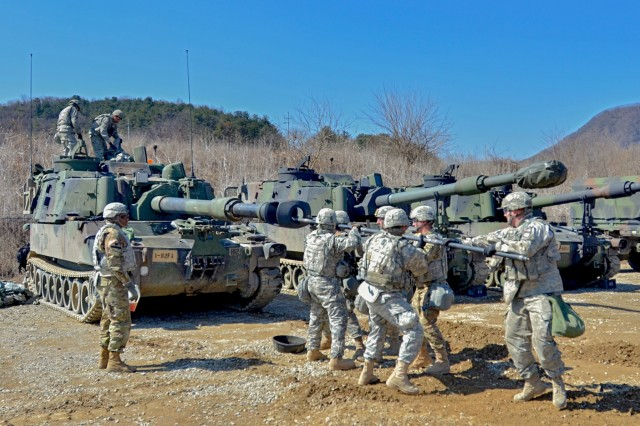 "Soldiers from the 1st Battalion, 82nd Field Artillery, 1st Armored Brigade Combat Team, 1st Cavalry Division, ""plug the gun,"" to clean the carbon out of their M109A6 Paladin after firing it at the Rodriguez Live Fire Range March 10. This week about 200 Soldiers from 1st Battaliion, 82nd FA, added to Dragon history by firing the first rounds in Korea since the unit was last here during the Korean War. (U.S. Army photo by Pfc. Dasol Choi, 1st Armored Brigade Combat Team Public Affairs, 1st Cavalry Division)"