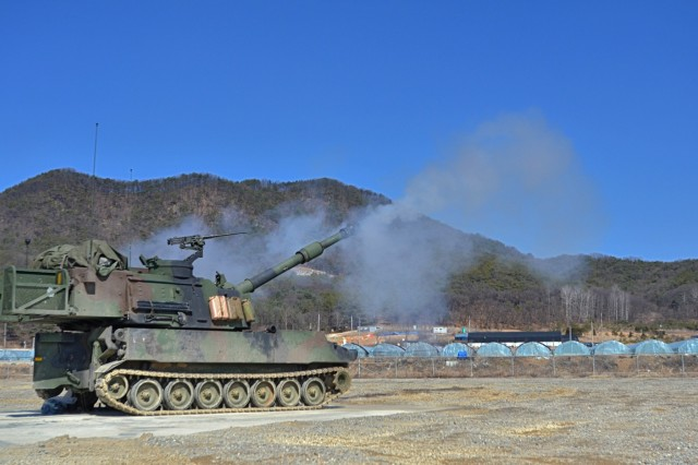 An artillery crew in a M109A6 Paladins fires rounds at Rodríguez Live Fire Range to certify during training March 10. This week about 200 Soldiers from the 1st Battalion, 82nd Field Artillery, 1st Armored Brigade Combat Team, 1st Cavalry Division, added to Dragon history by firing the first rounds in Korea since the unit was last here during the Korean War. (U.S. Army photo by Pfc. Dasol Choi, 1st Armored Brigade Combat Team Public Affairs, 1st Cavalry Division)