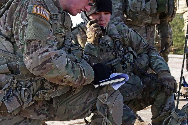 Spc. Miachael Scollard (left) and Pfc. Noah Whorton, both infantrymen assigned to Headquarters and Headquarters Troop, 3rd Squadron, 2nd Cavalry Regiment, use their notes and radio to call for indirect fire during a live-fire exercise certifying the scout platoon's ability to accurately call for fire, March 12, at Adazi Military Base, Latvia. Scollard and Whorton's platoon spent more than a week training with fire support specialists before conducting the live-fire certification during a rotation in Latvia in support of Operation Atlantic Resolve, a multinational demonstration of continued U.S. commitment to the collective security of North Atlantic Treaty Organization allies.