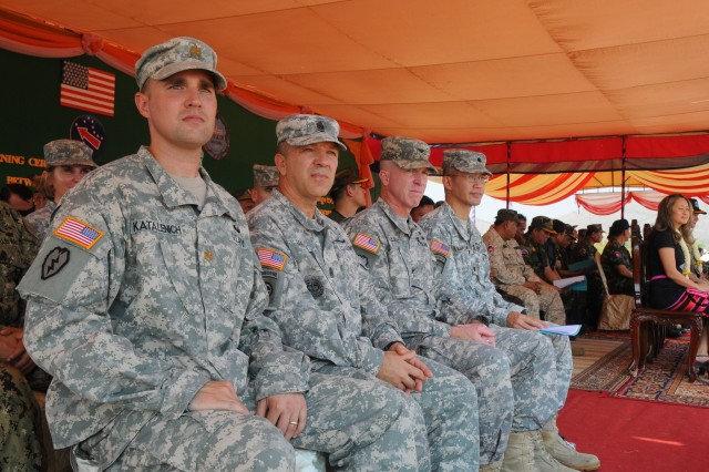 The 130th Theater Engineer Brigade's leadership looks out at the formation of participants as U.S. and Cambodian forces officially open Angkor Sentinel 2016, an annual bilateral military exercise hosted by the Royal Cambodian Armed Forces and sponsored by the U.S. Army Pacific, during a ceremony, March 14, 2016, at the Training School for Multinational Peacekeeping Forces in Kampong Speu Province, Cambodia.