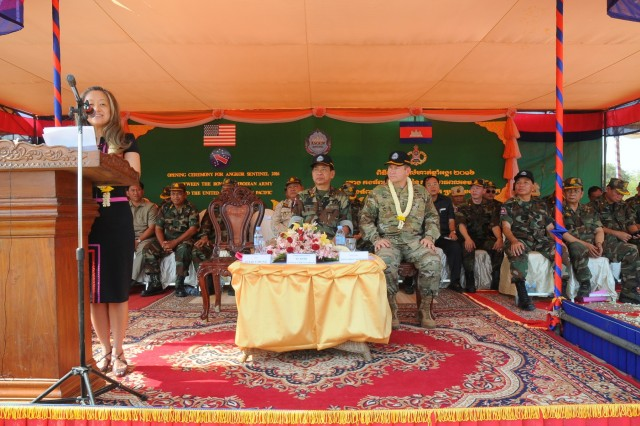 Lt. Gen. Chea Saran, Royal Cambodian Army's deputy commander of Army chief of staff, and Maj. Gen. Edward F. Dorman III, commander of 8th Theater Sustainment Command, listen to the Chargé d'affaires of the U.S. Embassy Phnom Penh, Julie Chung's welcoming remarks as U.S. and Cambodian forces open Angkor Sentinel 2016, an annual bilateral military exercise hosted by the Royal Cambodian Armed Forces and sponsored by the U.S. Army Pacific, during a ceremony, March 14, 2016, at the Training School for Multinational Peacekeeping Forces in Kampong Speu Province, Cambodia.