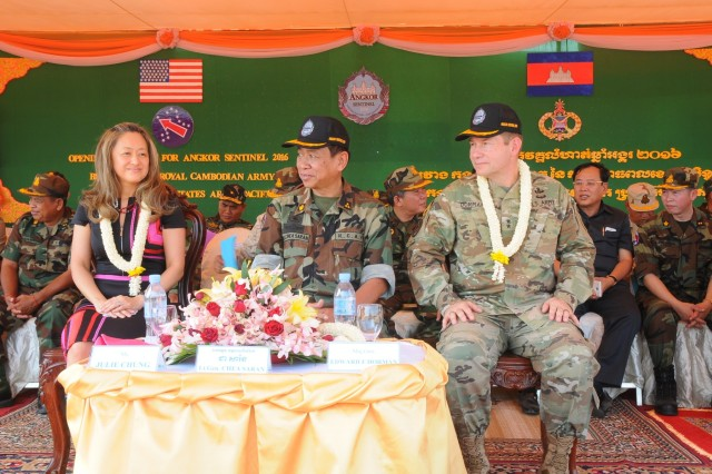 (Left to right) Julie Chung, chargé d'affaires of the U.S. Embassy Phnom Penh, Lt. Gen. Chea Saran, Royal Cambodian Army's deputy commander of Army chief of staff, and Maj. Gen. Edward F. Dorman III, commander of 8th Theater Sustainment Command, serve as the official party as U.S. and Cambodian forces open Angkor Sentinel 2016, an annual bilateral military exercise hosted by the Royal Cambodian Armed Forces and sponsored by the U.S. Army Pacific, during a ceremony, March 14, 2016, at the Training School for Multinational Peacekeeping Forces in Kampong Speu Province, Cambodia.