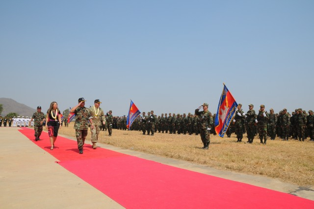 (Left to right) Julie Chung, chargé d'affaires of the U.S. Embassy Phnom Penh, Lt. Gen. Chea Saran, Royal Cambodian Army's deputy commander of Army chief of staff, and Maj. Gen. Edward F. Dorman III, commander of 8th Theater Sustainment Command, troop the line as U.S. and Cambodian forces open Angkor Sentinel 2016, an annual bilateral military exercise hosted by the Royal Cambodian Armed Forces and sponsored by the U.S. Army Pacific, during a ceremony, March 14, 2016, at the Training School for Multinational Peacekeeping Forces in Kampong Speu Province, Cambodia.