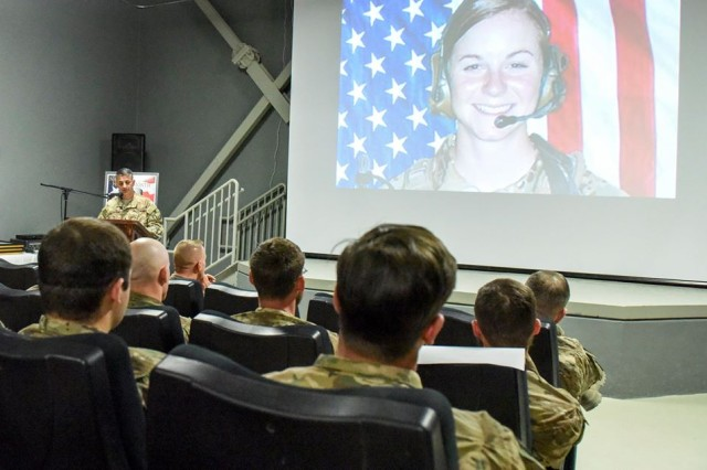 U.S. service members deployed to Bagram Airfield in Afghanistan listen as Brig. Gen. David Julazadeh, 455th Air Expeditionary Wing commander, talks about the contributions by fallen female service members, during a ceremony, March 7.