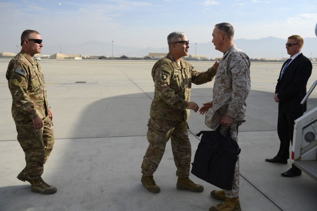 U.S. Army Gen. John Campbell, (center left), then-commander of Resolute Support Mission and United States Forces-Afghanistan, welcomes U.S. Marine Corps Gen. Joseph F. Dunford Jr., chairman of the Joint Chiefs of Staff, on Bagram Airfield, Afghanistan, Dec. 8, 2015.