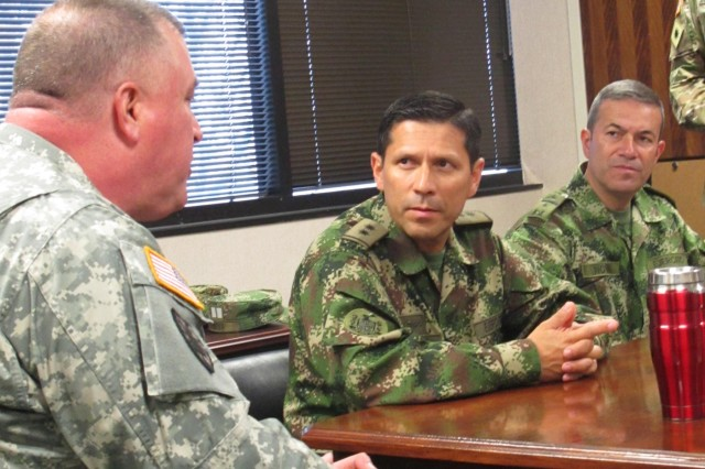 U.S. Army Brig. Gen. Van McCarty, deputy adjutant general of South Carolina, speaks to Colombian army Brig. Gen. Alexander Ramirez during a meeting March 9, 2016. Ramirez and five maintenance officers toured National Guard maintenance facilities in Columbia, Darlington and Charleston, to share best practices and watch Soldiers perform maintenance on a variety of vehicles.(U.S. Air National Guard Photo by 1st Lt. Stephen Hudson/Released)