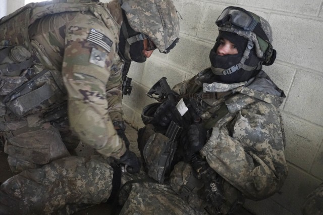 A Soldier with Company B, 2nd Battalion, 7th Cavalry Regiment, 3rd Armored Brigade Combat Team, 1st Cavalry Division, applies a tourniquet to a fellow Trooper, March 10, at Fort Hood, Texas.