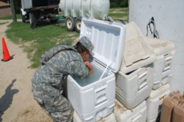 A Soldier cools down after working in the heat. Arm immersion cooling systems are expensive, said Jill Carlson, MCoE safety director, so Soldiers find various ways to cool down by using coolers, portable fans and much more.