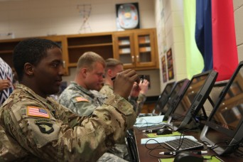 Soldiers of 3rd Battalion, 15th Infantry Regiment, 2nd Infantry Brigade Combat Team, 3rd Infantry Division participated in STEAM Night at Snelson-Golden Middle School in Hinesville, Georgia, March 10.