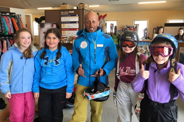 Girls from Camp Zama pose for a picture with two-time Olympian medalist, during a weekend of ski and snowboard fun held March 5 and 6 at Shiga Kogen, Nagano Ski Resort. (U.S. Army photo by Donna Araghi)