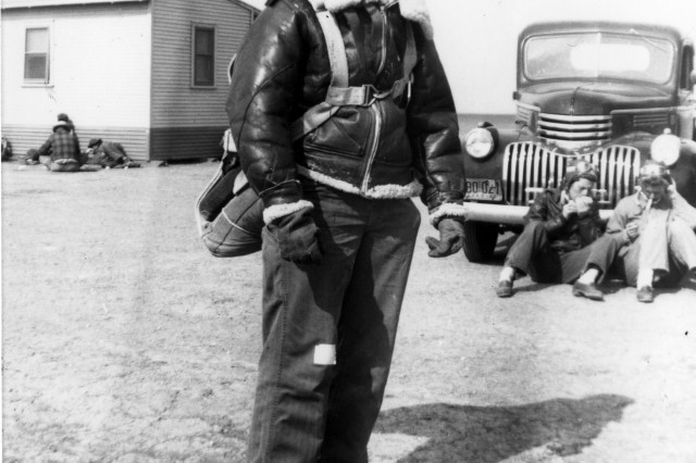 "Bernice ""Bee"" Haydu, a Women's Airforce Service Pilot, or WASP, during World War II, prepares to fly a Stearman Kaydet during flight training at an auxiliary field near Avenger Field in Sweetwater, Texas, in 1944. Because the plane was an open cockpit bi-plane, during the winter months, the pilots wore winter gear such as a fleece-lines helmet and pants. They would make flight notes on the adhesive tape on the pants."