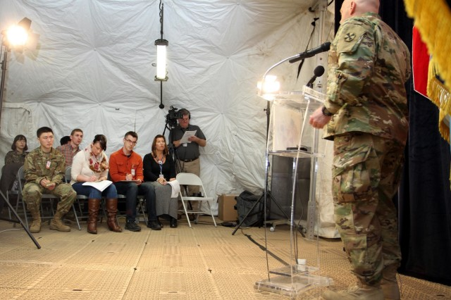 Col. Kelso Horne (right), operational protection officer, Eight Army, speaks at a notional press conference as members of the 109th Mobile Public Affairs Detachment, 213th Regional Support Group, Pennsylvania Army National Guard, and other exercise participants act as journalists.