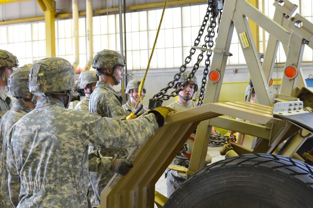 Soldiers from Fort Leonard Wood's 509th Clearance Company, 5th Engineer Battalion, dismantle a Husky Vehicle Mounted Mine Detection System Friday. Twelve of the unit's Huskies were taken apart and packed into 30 containers for shipment. Assisting with the operation were specialists from the U.S. Army TACOM Life Cycle Management Command and representatives from the Logistics Readiness Center, since it was the first dismantling operation of a Husky by the 509th. The Husky is a mine-protected vehicle that seeks out buried land mines and IEDs for investigation and neutralization.