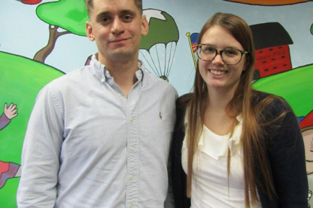 Capt. Darryl Kothmann and his wife, Lindsay, worked for more than two months on creating a colorful, cartoon mural for children at the Bruce C. Clarke Library.