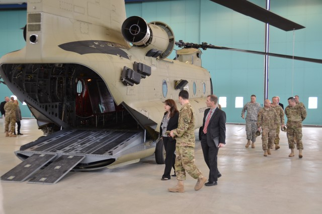 ANSBACH, Germany (March 21, 2016) -- Chief Warrant Officer 2 Lucas Odum explains the capabilities of the CH-47F Chinook helicopter to U.S. Consul General Jennifer D. Gavito of the consulate in Munich and Scott Woodard, the political/economic officer of the consulate. Gavito, Woodard and Brig. Gen. Christopher G. Cavoli, the commander of the 7th Army Joint Multinational Training Command, visited U.S. Army Garrison Ansbach Wednesday. (U.S. Army photo by Bryan Gatchell, USAG Ansbach Public Affairs)