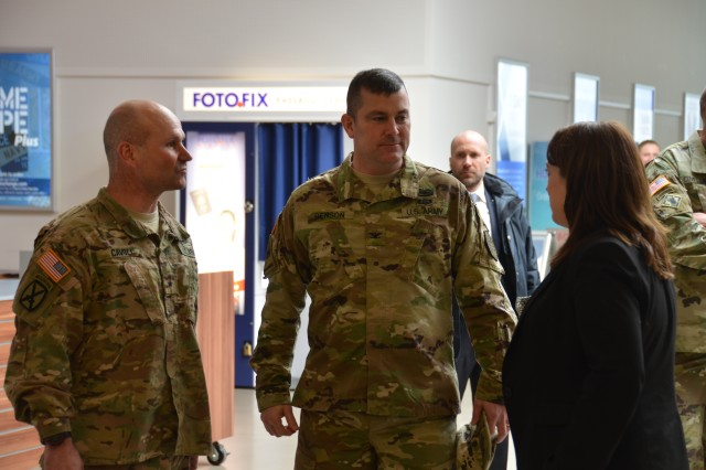 ANSBACH, Germany (March 21, 2016) -- Foreground from left, Brig. Gen. Christopher G. Cavoli, commander fo the 7th Army joint Multinational Training Command, Col. Christopher M. Benson, U.S. Army Garrison Ansbach commander, and U.S. Consul General Jennifer D. Gavito of the U.S. consulate in Munich, speak at the Post Exchange at Urlas Community. Gavito and Cavoli visited USAG Ansbach Wednesday. (U.S. Army photo by Bryan Gatchell, USAG Ansbach Public Affairs)