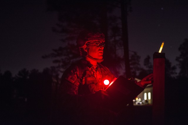 Sgt. Abraham Amavisca, a practical nursing noncommissioned officer with the 7305th Medical Training Support Battalion out of Sacramento, California checks his azimuth one last time before venturing out to his first point during the night land navigation March 8, 2016 as part of Army Reserve Medical Command's 2016 Best Warrior at Fort Gordon, Ga. (U.S. Army photo by Sgt. 1st Class Brian Hamilton 108th Training Command- Initial Entry Training Public Affairs)